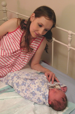 Anna and Daughter Number 2 on bed