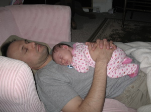 Daughter Vivienne sleeping on her Dad.